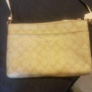 Tan Coach crossbody bag. New condition